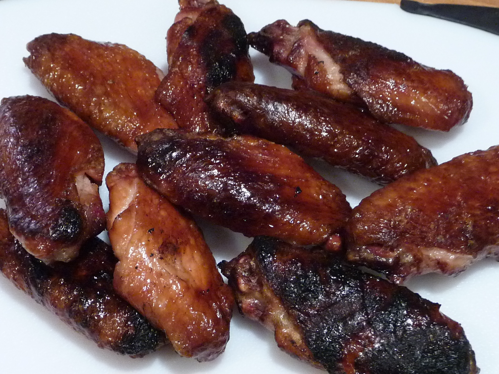 Our smoke grilled wings just waiting for the sprinkle...