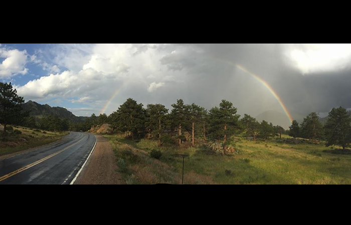 Kate snapped this pic of a full rainbow our our way out of Rocky Mountain National Park.