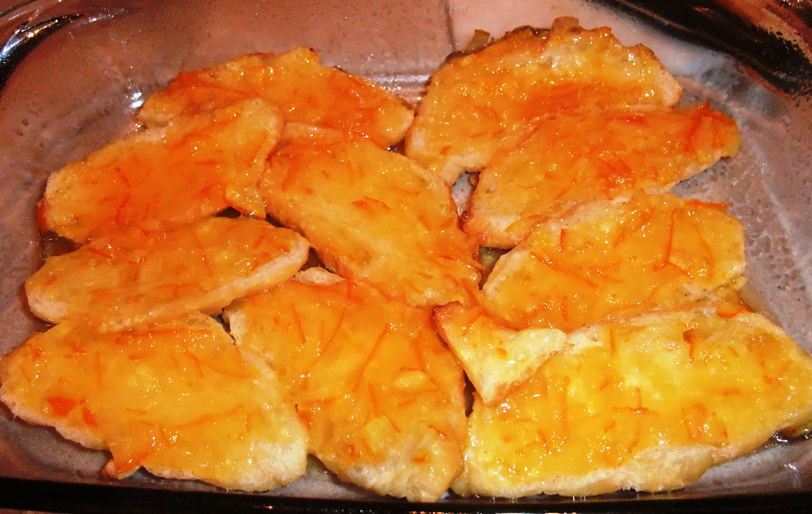 Croissant breakfast casserole made with orange marmalade, eggs, and cream--luscious, and super easy.