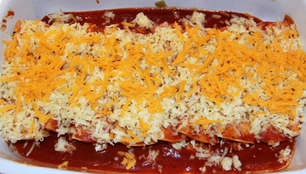 Chicken Enchiladas are a family favorite and a great make-ahead dish for a party—this recipe uses cream cheese to make the enchiladas extra creamy and delicious!
