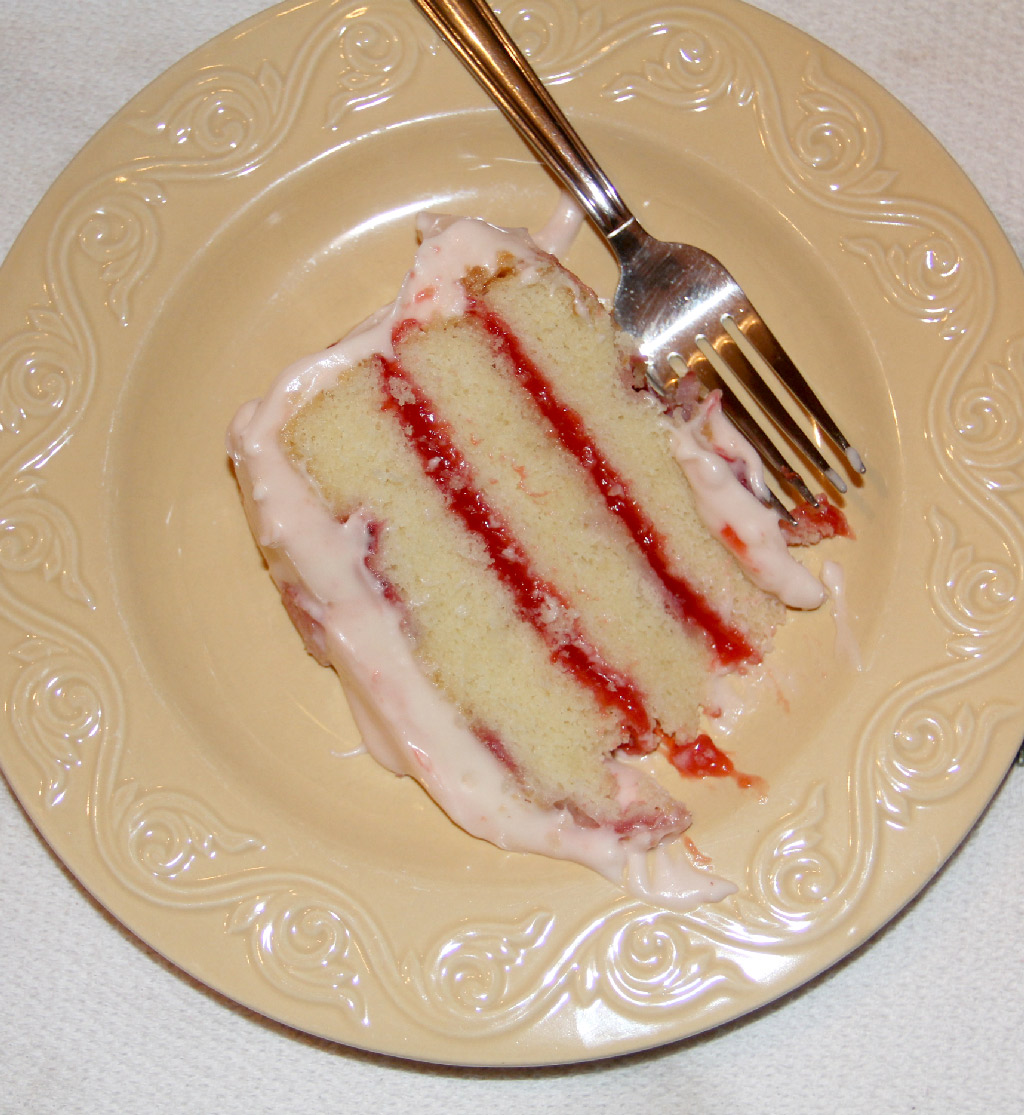 Fresh strawberry cake filled with strawberry-lemon jam and topped with a fresh strawberry cream cheese frosting—this is a special occasion show-stopper and it's divine!