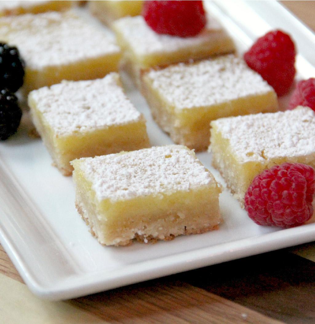 Easy lemon bars with a zesty lemon custard atop a crisp brown sugar shortbread crust--these lemon bars lovely and delicious!