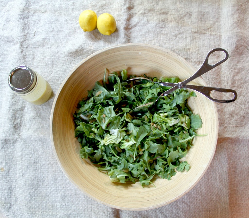 Green Salad with arugula and fresh herbs, topped with simple lemon vinaigrette!