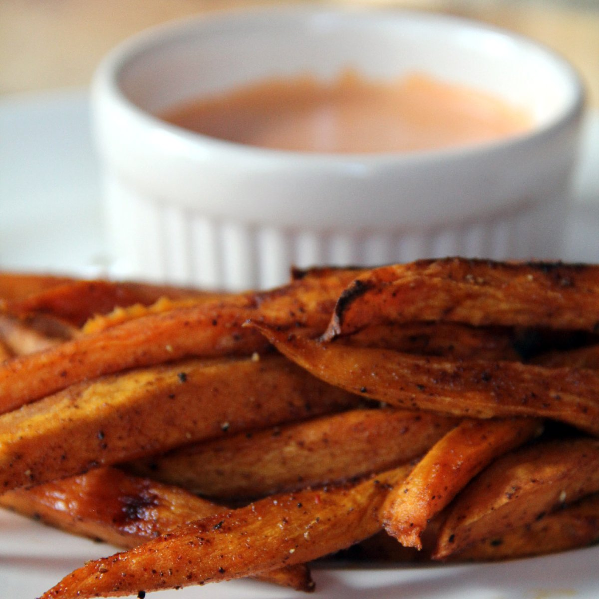 Homemade Sweet Potato Fries — these oven baked sweet potato fries are just the right mix of sweet and spicy!