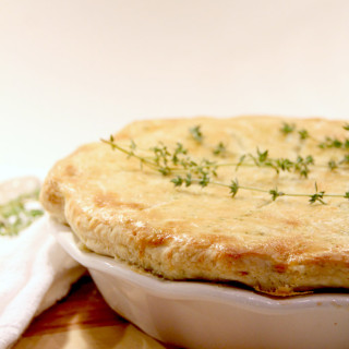 Chicken pot pie with rich, creamy sauce and filled with vegetables, topped with a savory thyme crust. Delicious comfort food!