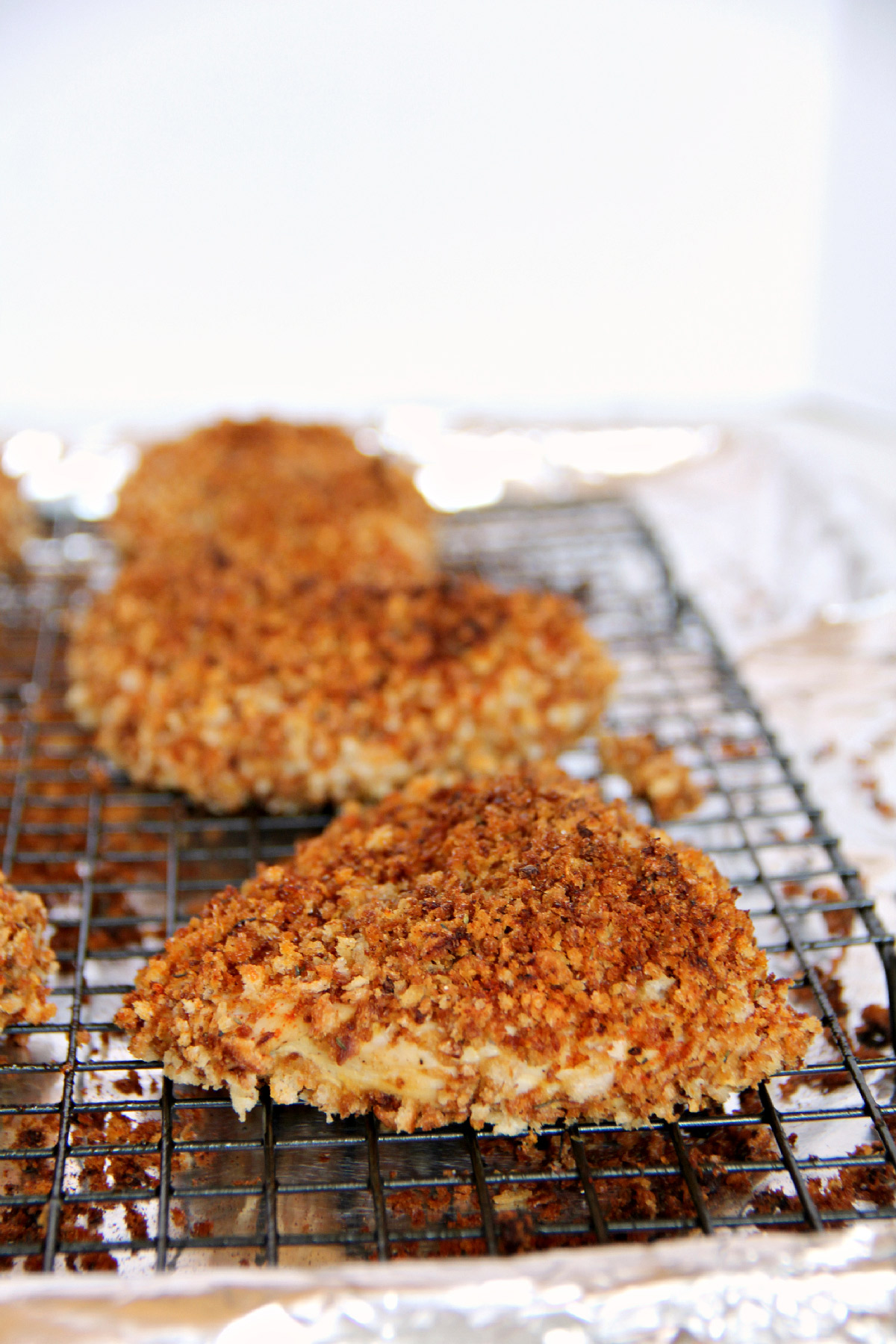 Crispy Chicken—delicious, juicy baked chicken with a crispy garlic panko coating. | inasouthernkitchen.com