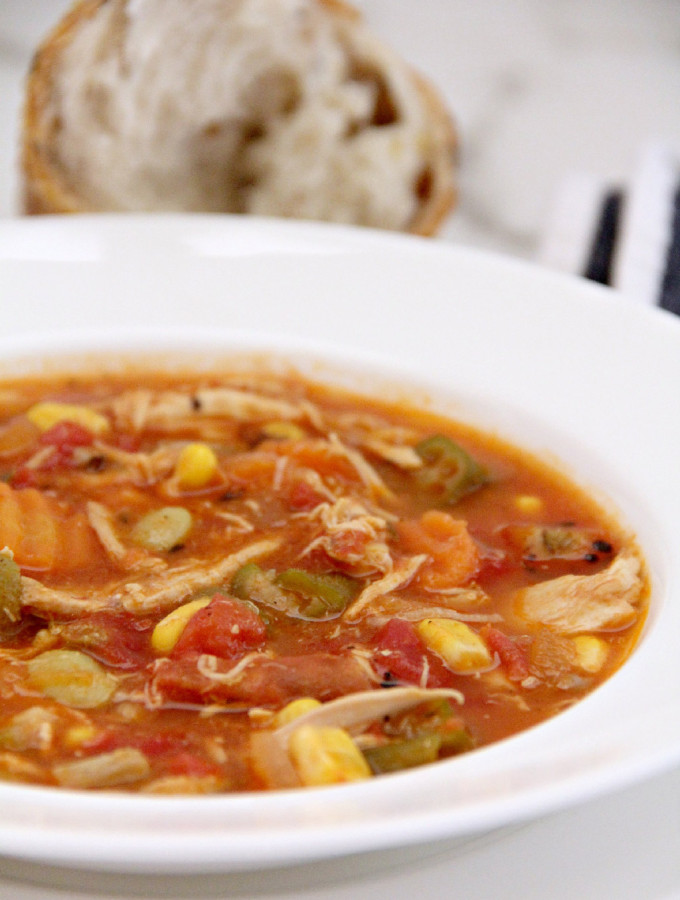Chicken and vegetable soup is filled with shredded chicken, tomatoes, beans, corn, okra, and onion—all frozen so no chopping!