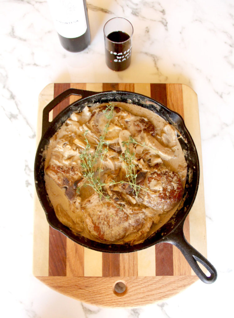 Pork Chops with Apples and Onions -- one skillet meal with pork chops, sliced apples and onions, and a delicious sauce!