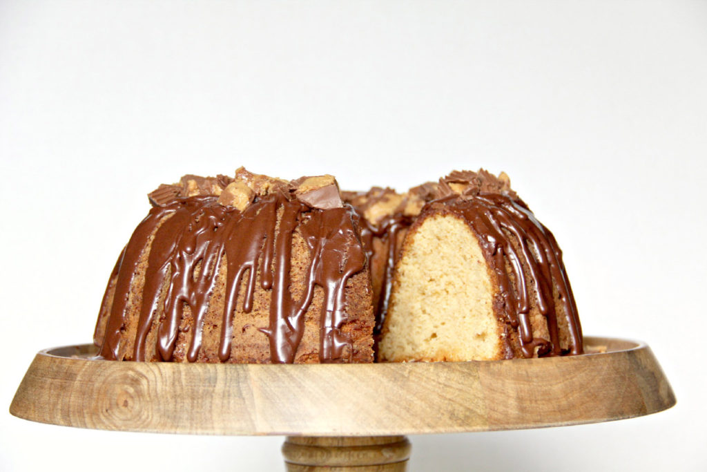 Peanut Butter Pound Cake topped with chocolate glaze and crumbled Reese's peanut butter cups.