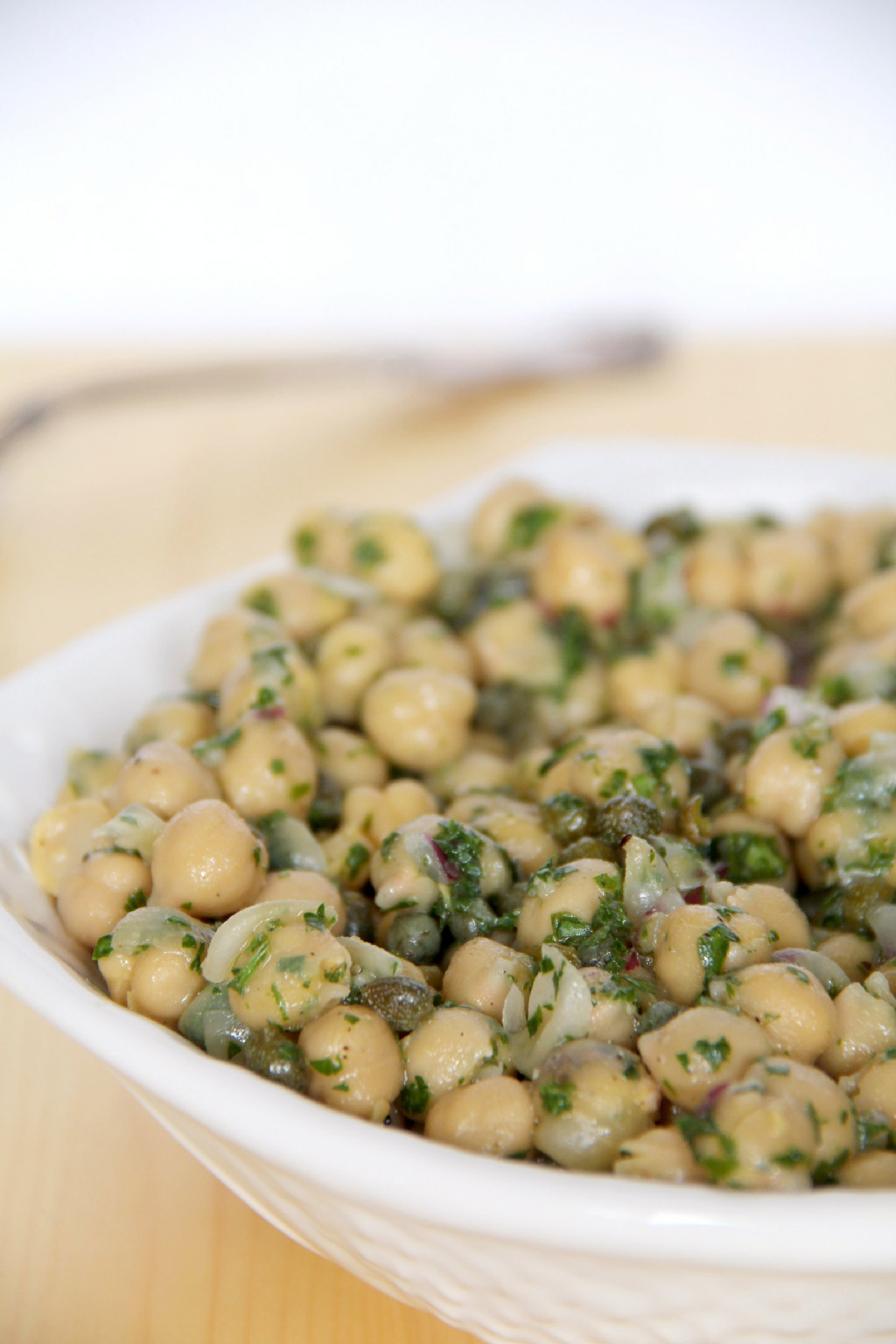 Chickpea salad that's super easy and healthy, with just chickpeas, parsley, onion, and capers, mixed with a lemon vinaigrette.