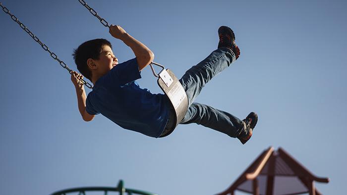 Kid Swinging 700X394