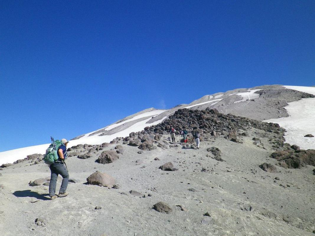 Heading up the ash field to the summit. Photo Credit: Megan Hill