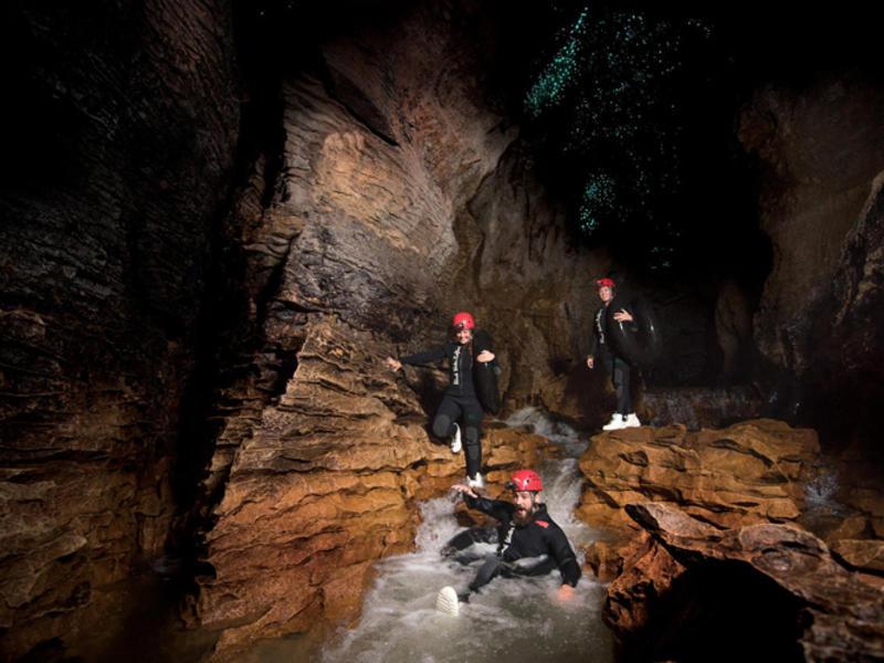 The legendary black water rafting company 1516 nz black abyss tubing