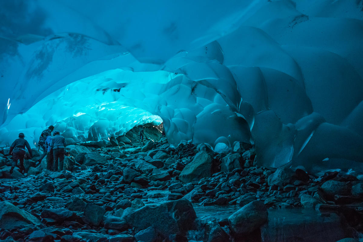 Crawl your way throught the icy universe of the Mendenhall Ice Caves in Alaska. Photo Credit: Andrew E. Russell via Flickr