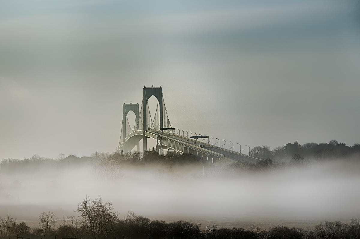 Claiborne Pell Bridge in mist, Newport RI by Timothy Burling via Flickr Creative Commons