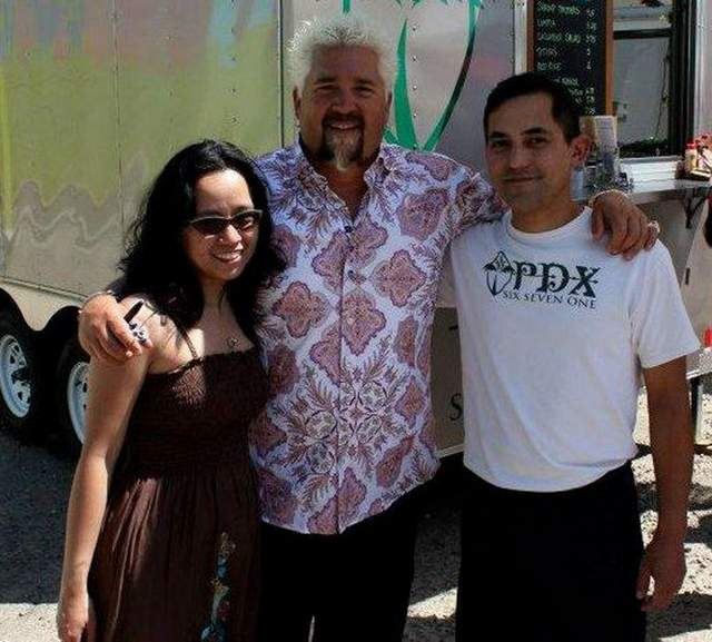 Dive: Guy Fieri, center, stands with Marie Sablan and Edward Calvo Sablan, former Guam residents and owners of food truck PDX671 in Oregon. Their Chamorro cuisine will be featured on Food Network. Courtesy of PDX671