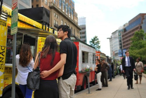 Katherine Ip, left center, is embraced by Calvin Lu as they wait outside a food truck parked at Farragut Square on Thursday, May 9, 2013, in Washington, D.C. (Matt McClain/The Washington Post)