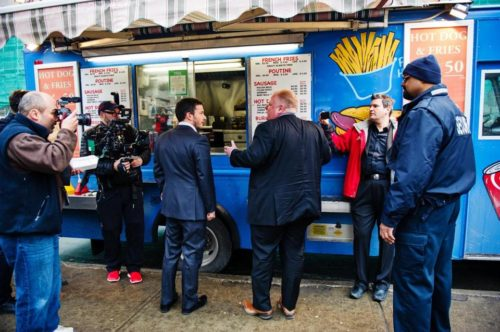 At a food truck outside Toronto City Hall, Giles Coren, restaurant critic (left), gets an earful from Mayor Rob Ford (who since lost his reelection bid).