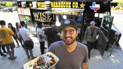Roaming Hunger acts as a clearinghouse of sorts for the food truck industry, connecting customers across the country with a directory of more than 6,000 mobile vendors. Above, founder Ross Resnick, 30, holding a barbecue brisket sandwich from the Wise Barbecue food truck, one of the company's primary vendors. (Mel Melcon / Los Angeles Times)