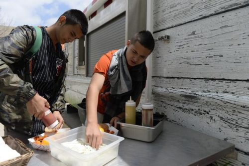 BOULDER, CO - APRIL 28:  Centaurus High School students Jose Rodriguez, left, and Ruben Diaz get their utensils and condiments at the Boulder Valley School District's food truck in front of Centaurus High School April 28, 2015. (Photo by Andy Cross/The Denver Post)