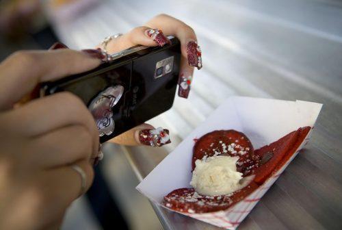 A customer photographs her Buttermilk Truck red velvet chocolate chip pancake. Anne Fishbein