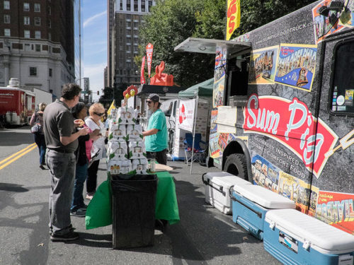 Steve Koste, owner of the Sum Pig food truck waits on customers on Arch Street near Brad. (ED HILLE / Staff Photographer ) ED HILLE / Staff Photographer