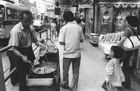 A street vendor sells stinky tofu from a cart.