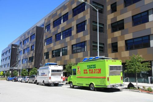 Two food trucks on a quiet day (or least a quiet moment) in  Seattle. Photographer: James S. Russell/Bloomberg