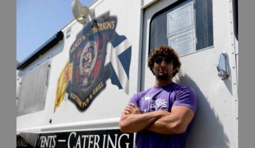 FILE - Ryan Giannoni poses for a portrait in front of a food truck  that was featured at the 2015 Doggie Carnival in Savannah.