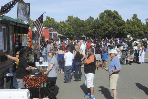 Hundreds of hungry food truck fans came to Suisun  City's Downtown Waterfront, Saturday, to take  part in an event organized by the mobile food  truck group, SactoMoFo.