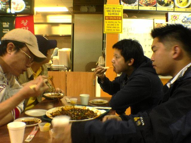 me, han, yush, alex eating some grub at assi shopping plaza in atl