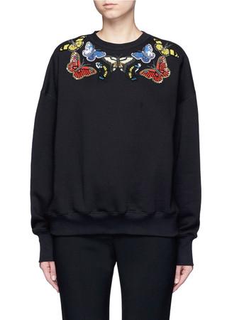 Butterfly embellished fleece sweatshirt