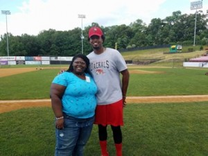 Habirah Williams, a participant in the program for high school students, interviews Jackals Infielder Art Charles.