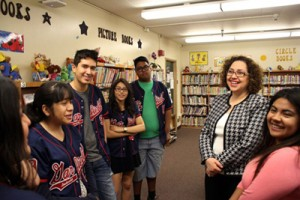 Dr. Bianca Guzman, second from right, stands with students at Garfield High School. (Photo courtesy of Cal State L.A. Office of Communication and Public Affairs)
