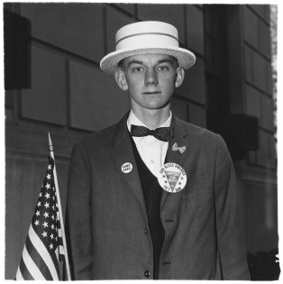 Diane Arbus - Boy with a straw hat waiting to march in a pro-war parade, N.Y.C. (1967), Martin-Gropius-Bau Museum