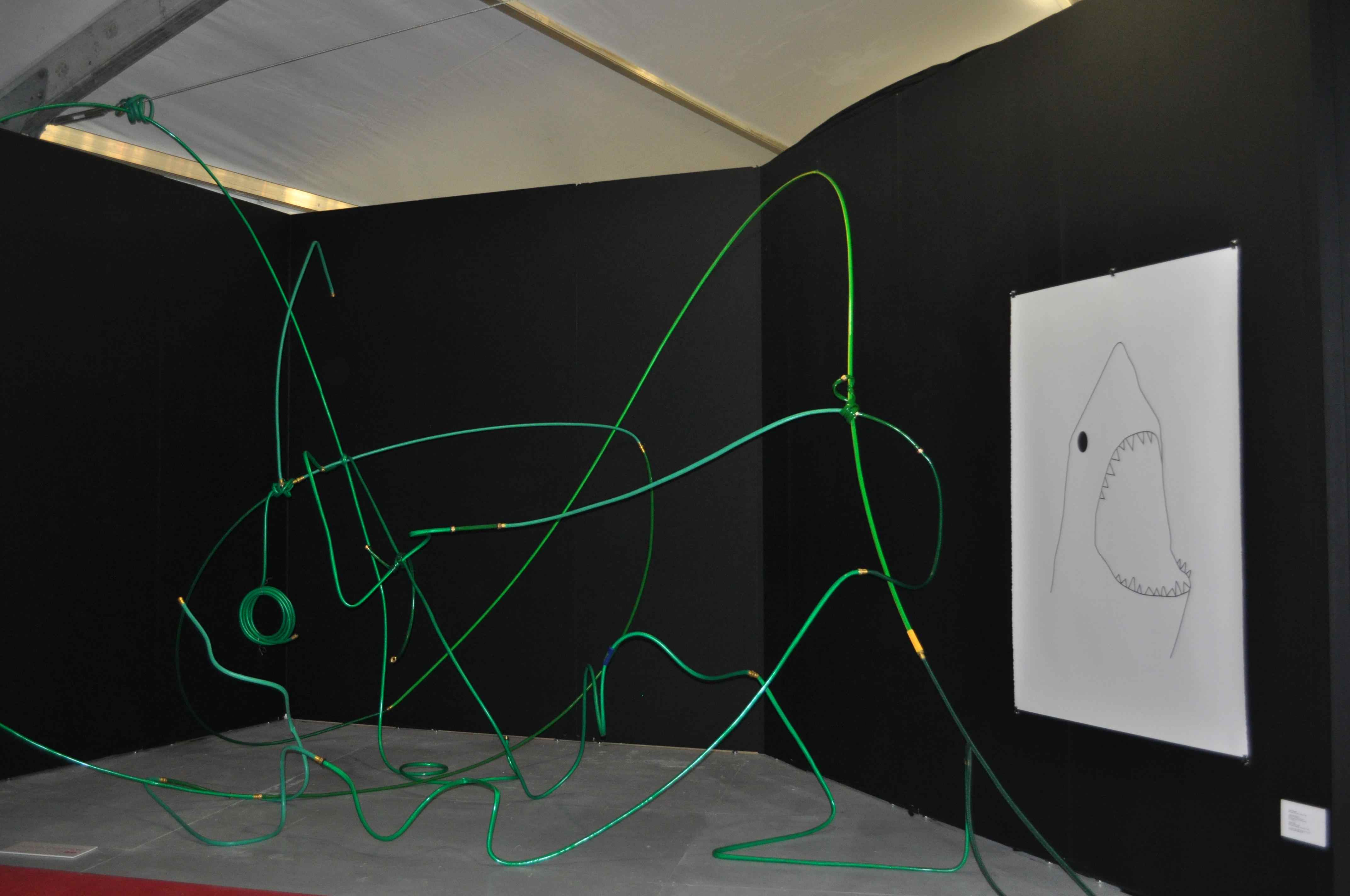 Justin Cooper's Hose Lits in the entryway of Untitled Art Fair