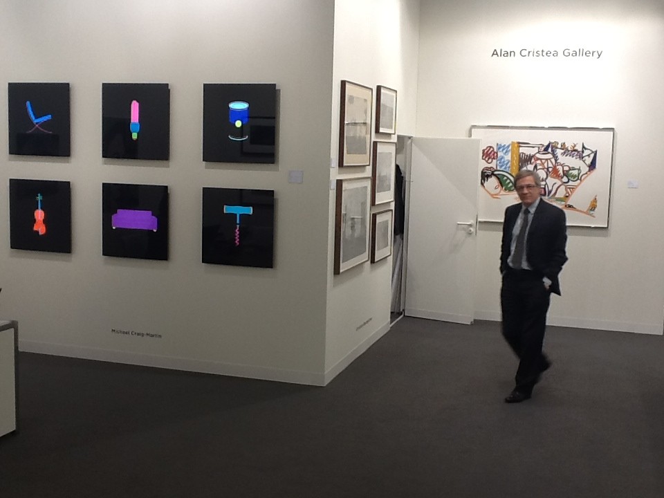 Alan Cristea with works by Michael Craig-Martin on The Alan Cristea Gallery Stand at Art Basel 2013