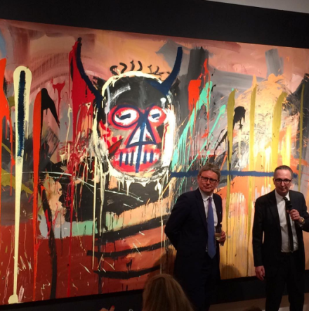 Jussi Pylkkanen and Bretty Gorvy in front of the Record-setting Basquait, via Art Observed