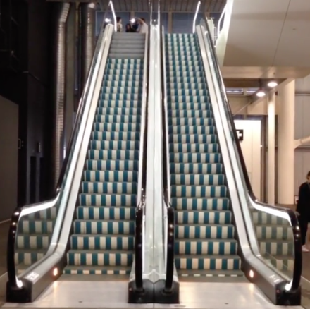 Escalator Installation by Daniel Buren, via Andrea Nguyen for Art Observed
