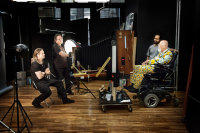 Chuck Close photographic Brad Pitt with a large-format camera, via NYT