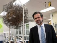 DIA director Salvador Salort-Pons with a David Hammons work, via Detroit Free Press
