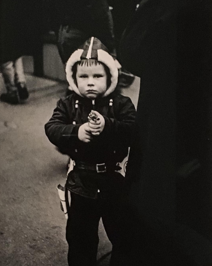Diane Arbus, Kid in a hooded jacket aiming a gun, N.Y.C. (1957), via Art Observed