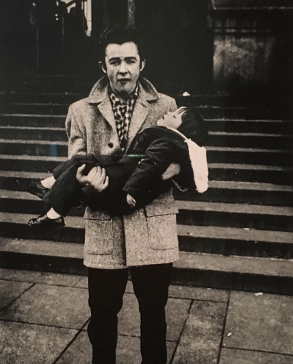Diane Arbus, Man holding a sleeping child, N.Y.C. (1957), via Art Observed