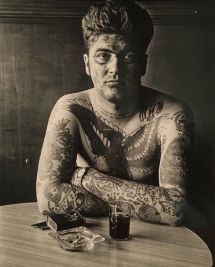 Diane Arbus, Jack Dracula at a bar, New London, Conn (1961), via Art Observed
