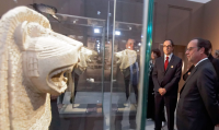francois-hollande-at-storage-facility-via-the-guardian