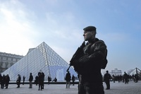 Soldier at Louvre, via Art Newspaper