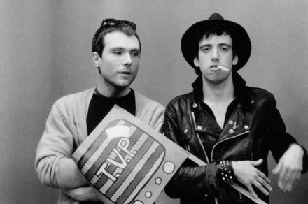 Glenn O'Brien with Mick Jones of The Clash, via NYT