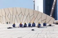 Workers at the National Museum of Qatar, via Art Newspaper