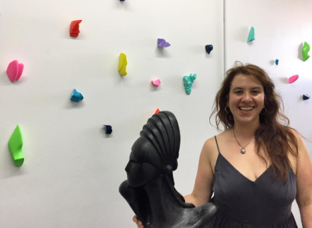 Artist Sophia Angelakis with a series of her small scale sculptures, via Art Observed