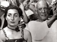 Artist Pablo Picasso and his wife Jacqueline Roque at a bullfight